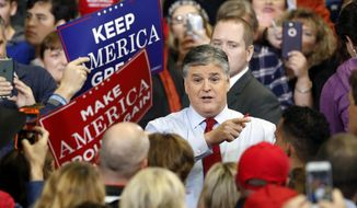 Television personality Sean Hannity speaks to members of the audience while signing autographs before the start of a campaign rally Monday, Nov. 5, 2018, in Cape Girardeau, Mo., with President Donald Trump. (AP Photo/Jeff Roberson) ** FILE **