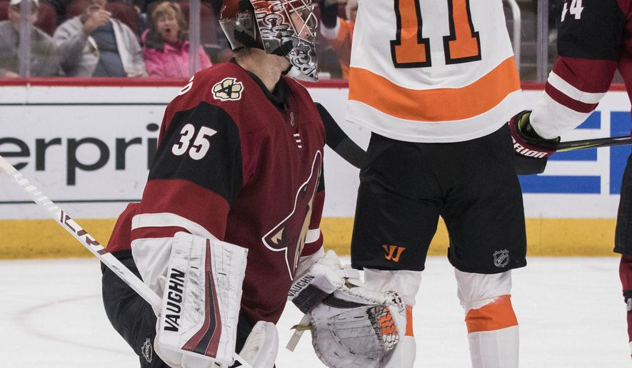 Philadelphia Flyers' Travis Konecny (11) celebrates his goal against the Arizona Coyotes goalie Darcy Kuemper (35) the first period of an NHL hockey game Monday, Nov. 5, 2018, in Glendale, Ariz. (AP Photo/Darryl Webb)