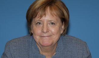 German Chancellor and chairwoman of the German Christian Democratic Union (CDU), Angela Merkel, arrives for a closed-door meeting in Berlin, Germany, Sunday, Nov. 4, 2018. (AP Photo/Michael Sohn)