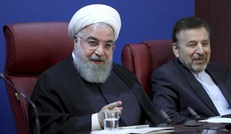 """In this photo released by official website of the office of the Iranian Presidency, President Hassan Rouhani speaks in a meeting with finance ministry officials in Tehran, Iran, Monday, Nov. 5, 2018. Iran greeted the re-imposition of U.S. sanctions on Monday with air defense drills and an acknowledgement from President Hassan Rouhani the nation faces a """"war situation,"""" raising Mideast tensions as America's maximalist approach to the Islamic Republic takes hold. (Iranian Presidency Office via AP)"""