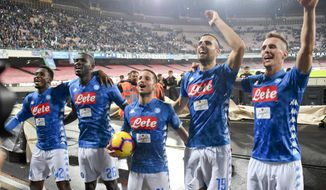 Napoli's forward Dries Mertens, center, celebrates with his teammates at the end of the Italian Serie A soccer match between Napoli and Empoli at the San Paolo stadium in Naples, Italy, Friday, Nov. 2,  2018. Mertens scored three goals in Napoli 5 - 1 victory. (Ciro Fusco/ANSA via AP)