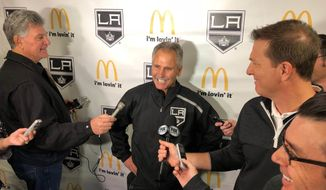 Los Angeles Kings interim coach Willie Desjardins reacts to a question from reporters after his first practice with his new team on Monday, Nov. 5, 2018, in Los Angeles. Desjardins is taking over for the fired John Stevens with hopes of improving the Kings' NHL-worst start to the season. (AP Photo/Greg Beacham)