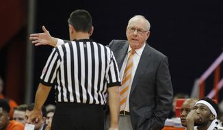 Syracuse coach Jim Boeheim, right, talks with official Pat Driscoll during the second half of the team's college basketball exhibition game against Le Moyne in Syracuse, N.Y., Wednesday, Oct. 31, 2018. (AP Photo/Nick Lisi)