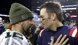 Green Bay Packers quarterback Aaron Rodgers, left, and New England Patriots quarterback Tom Brady speak at midfield after an NFL football game, Sunday, Nov. 4, 2018, in Foxborough, Mass. (AP Photo/Steven Senne) **FILE**