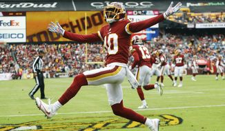 FILE- In this Oct. 14, 2018 file photo, Washington Redskins wide receiver Paul Richardson (10) celebrates his touchdown during the first half of an NFL football game against the Carolina Panthers, in Landover, Md. Both starting guards for the Washington Redskins, Brandon Scherff and Shawn Lauvao, will have season-ending surgery, as will wide receiver Richardson. Richardson has been dealing with a shoulder problem that now needs an operation. (AP Photo/Patrick Semansky) ** FILE **