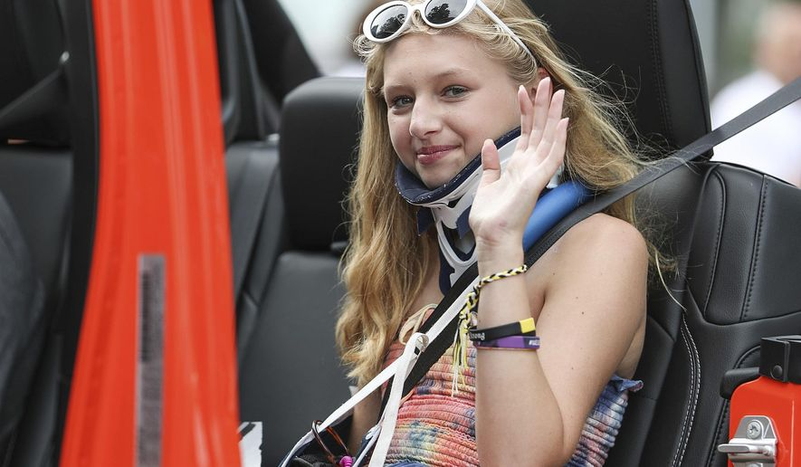 """FILE - In this July 4, 2018 file photo, Ella Whistler serves as a grand marshal as she rides with her family in the Fourth of July Parade in Noblesville, Ind. Wistler survived a school shooting by a 13 year-old boy at Noblesville West Middle School in May. The boy admitted in court Monday, Nov. 5, 2018, to shooting and wounding a classmate and a teacher at the suburban Indianapolis school, saying in a statement read by his attorneys during a juvenile court hearing that, """"If I could, I would take it back."""" (Jenna Watson/The Indianapolis Star via AP File)"""