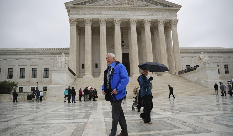 Alaska resident John Sturgeon walks outside the Supreme Court, Monday, Nov. 5, 2018 in Washington. Sturgeon sued the Park Service in 2011 after it told him to stop operating his hovercraft on stretch of the Nation river that passes through the federally created preserve. The State of Alaska would permit this, but the National Park Services regulations said he could not. (AP Photo/Pablo Martinez Monsivais)