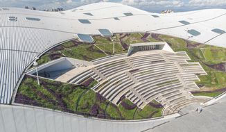 In this undated handout photo provided Nov. 5, 2018, by the National Kaohsiung Center for the Arts, the National Kaohsiung Center for the Arts designed by Dutch architect Francine Houben is seen in Kaohsiung in southern Taiwan. A sprawling complex of four theaters billed as the biggest performing arts center in the world has opened in southern Taiwan. (National Kaohsiung Center for the Arts via AP)