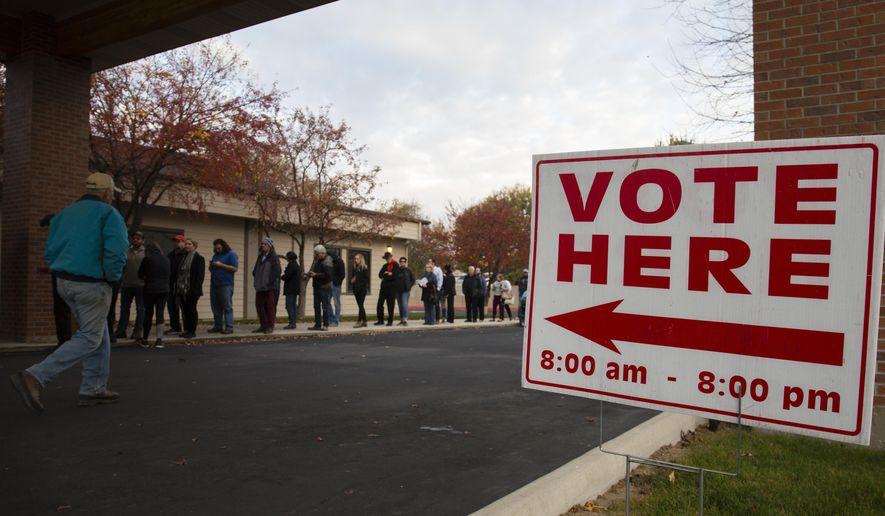 Voters wait in line as the polls open at Pierce Park Baptist Church in Boise, Idaho, Tuesday, Nov. 6, 2018. (AP Photo/Otto Kitsinger)