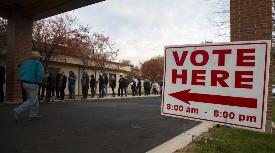 Voters wait in line as the polls open at Pierce Park Baptist Church in Boise, Idaho, Tuesday, Nov. 6, 2018. (AP Photo/Otto Kitsinger)