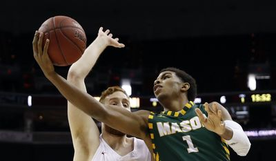 Saint Joseph's forward Anthony Longpre (12) defends as George Mason guard Justin Kier (1) shoots during the first half of an NCAA college basketball in the quarterfinals of the Atlantic 10 Conference tournament, Friday, March 9, 2018, in Washington. Saint Joseph's won 68-49. (AP Photo/Alex Brandon) **FILE**