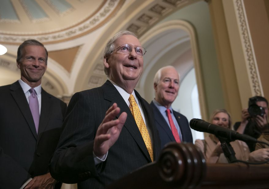 Senate Majority Leader Mitch McConnell, R-Ky., flanked by Sen. John Thune, R-S.D., left, and Majority Whip John Cornyn, R-Texas, speaks with reporters following their weekly policy meetings, at the Capitol in Washington, Tuesday, Aug. 28, 2018. (AP Photo/J. Scott Applewhite)