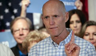 Republican Gov. Rick Scott opposed the measure, arguing that felons should have to complete a process before having their rights reestablished. (Associated Press)