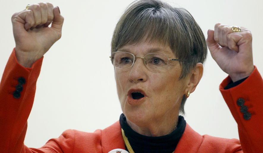Democratic candidate for Kansas Governor, Laura Kelly, talks to supporters during a rally at the New Bethel Church Saturday, Nov. 3, 2018, in Kansas City, Kan. Kelly is challenging Republican Secretary of State Kris Kobach for the open seat. (AP Photo/Charlie Riedel)