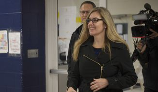 Virginia Democratic congressional candidate Jennifer Wexton, a former prosecutor and current Democratic state senator, arrives to vote, Tuesday, Nov. 6, 2018 in Leesburg, Va. Wexton is running against two-term Rep. Barbara Comstock, R-Va. (AP Photo/Douglas Graham)