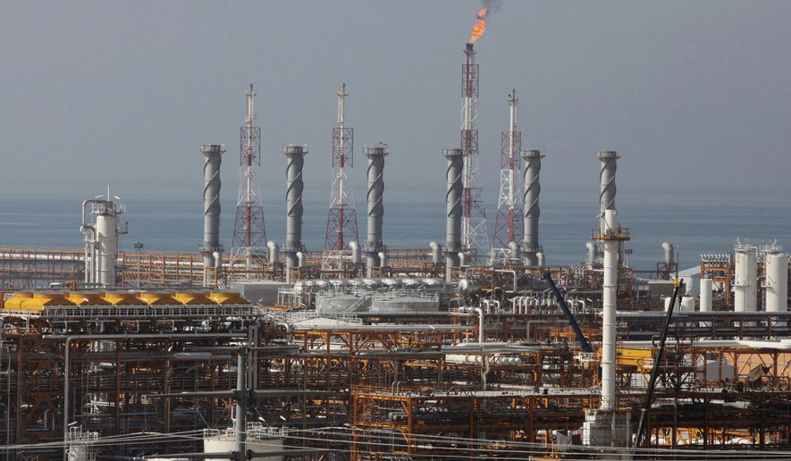 In this Jan. 22, 2014, file photo, a partially constructed gas refinery at the South Pars gas field is seen on the northern coast of Persian Gulf in Asalouyeh, Iran. (AP Photo/Vahid Salemi, File)