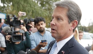 Georgia Republican gubernatorial candidate Brian Kemp speaks to reporters after voting Tuesday, Nov. 6, 2018, in Winterville, Ga. Kemp is in a close race with Democrat Stacey Abrams. (AP Photo/John Bazemore)