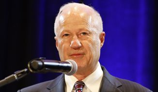 United States Rep. Mike Coffman, R-Colo., 6th District, delivers his concession speech during an election night party in Lone Tree, Colo., Tuesday, Nov. 6, 2018. (AP Photo/Jack Dempsey)