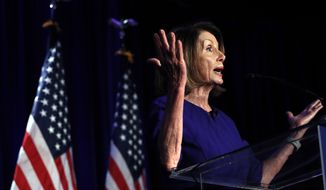 House Democratic Leader Nancy Pelosi of Calif., speaks to a crowd of volunteers and supporters of the Democratic party at an election night returns event at the Hyatt Regency Hotel, on Tuesday, Nov. 6, 2018, in Washington. (AP Photo/Jacquelyn Martin)