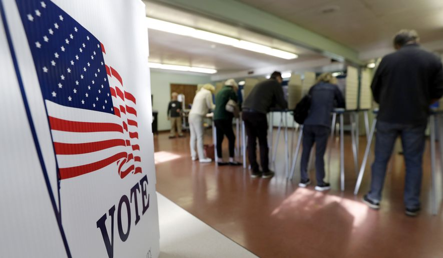 In this file photo, voters cast their ballots on Tuesday, Nov. 6, 2018, in Gates Mills, Ohio. Across the country, voters headed to the polls Tuesday in one of the most high-profile midterm elections in years. (AP Photo/Tony Dejak) **FILE**