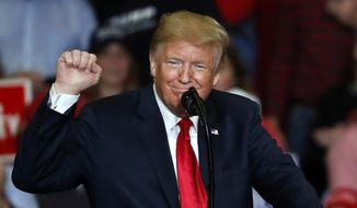 President Donald Trump pumps his fist as he speaks during a campaign rally Monday, Nov. 5, 2018, in Cape Girardeau, Mo. (AP Photo/Jeff Roberson)