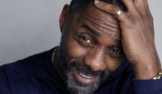 """Actor-director Idris Elba poses for a portrait to promote his film """"Yardie"""" at the Music Lodge during the Sundance Film Festival in Park City, Utah, Jan. 21, 2018. On Monday, Nov. 5, 2018, Elba was named Sexiest Man Alive by People magazine. (Photo by Taylor Jewell/Invision/AP)  ** FILE **"""