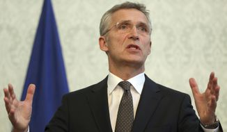NATO Secretary General Jens Stoltenberg, speaks during a press conference with Afghan President Ashraf Ghani, at the presidential palace, in Kabul, Afghanistan, Tuesday, Nov. 6, 2018. (AP Photo/Massoud Hossaini)