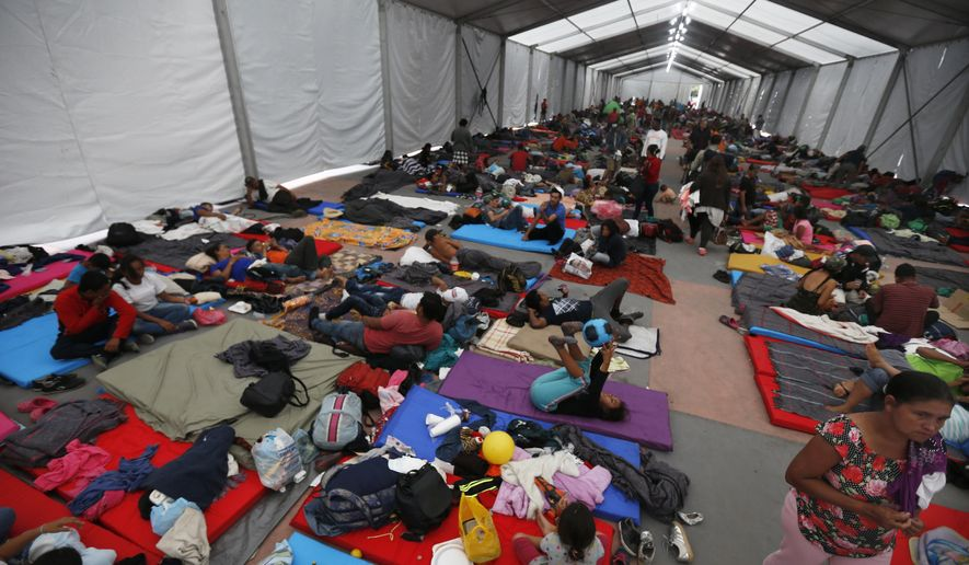Central American migrants, part of a caravan hoping to reach the U.S. gets settled in a shelter at the Jesus Martinez stadium, in Mexico City, Monday, Nov. 5, 2018. Thousands of Central American migrants have arrived at the stadium, still hundreds of miles away from their goal of reaching the U.S. a day before midterm elections in which they unwittingly became a central issue. (AP Photo/Marco Ugarte)