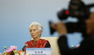 International Monetary Fund (IMF) Managing Director Christine Lagarde attends a news briefing after the Third Round Table Dialogue in Beijing, Tuesday, Nov. 6, 2018. (Thomas Peter/Pool Photo via AP)
