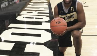 In this Tuesday, Oct. 30, 2018 photo, Colorado forward Evan Battey poses on team's court in Boulder, Colo. Battey, a redshirt freshman from California, suffered a stroke and two seizures last December and, after 11 months of rehabilitation, is ready to make his on-court debut with the Golden Buffaloes. (AP Photo/Pat Graham, File)