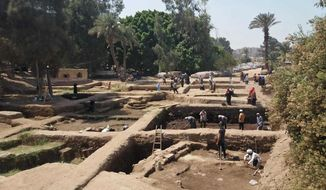 This undated photo released by the Egyptian Ministry of Antiquities, shows archeologists working at a dig in eastern Cairo's Matariya neighborhood, Egypt. The Antiquities Ministry said on Tuesday, Nov. 6, 2018, that archeologists working at the dig have found several fragments of stone slabs with inscriptions dating back up to 4,000 years. Some of the fragments date back to the 12th and the 20th Dynasties and the Third Intermediate Period while others are more recent. (Egyptian Ministry of Antiquities via AP)