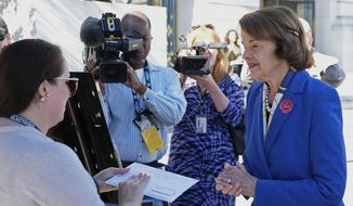 U.S. Sen. Dianne Feinstein drops off her vote-by-mail ballot outside City Hall Monday, Nov. 5, 2018, in San Francisco. Feinstein, who is seeking her fifth full term in the Senate, is being challenged by fellow Democrat, state Sen. Kevin de Leon. (AP Photo/Eric Risberg)