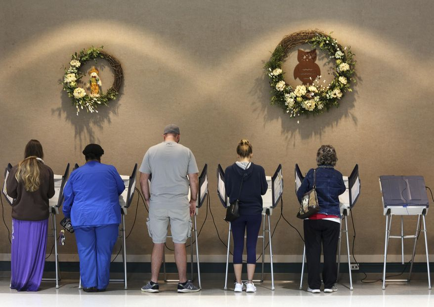 Voters cast their ballots Tuesday, Nov. 6, 2018, at Rossville City Hall in Rossville, Ga. (Erin O. Smith/Chattanooga Times Free Press via AP)