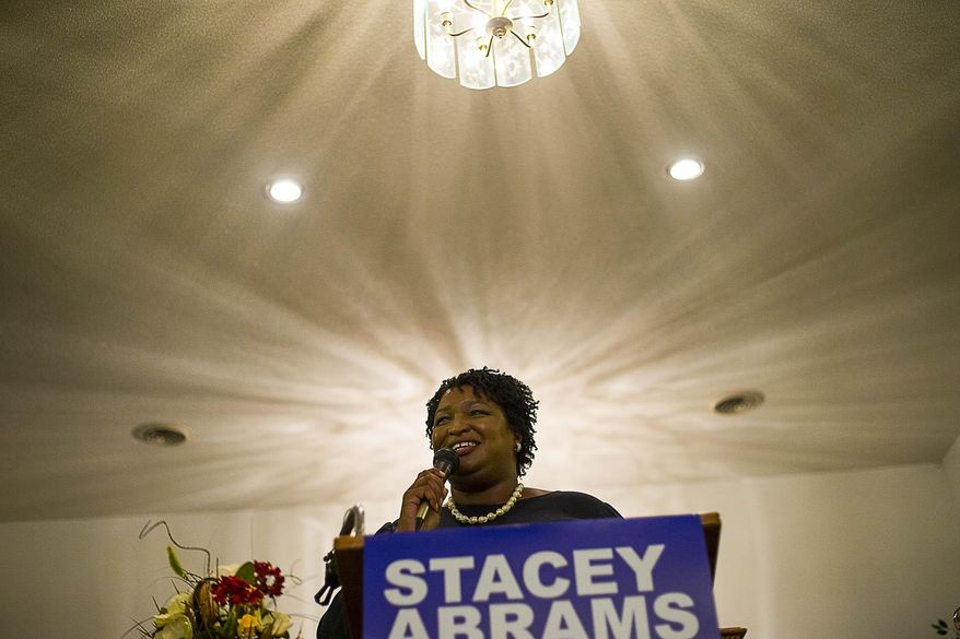 "Stacey Abrams vowed to file a federal lawsuit over the way Georgia's elections are run. ""It was not a free and fair election,"" (Alyssa Pointer/Atlanta Journal-Constitution via AP)"
