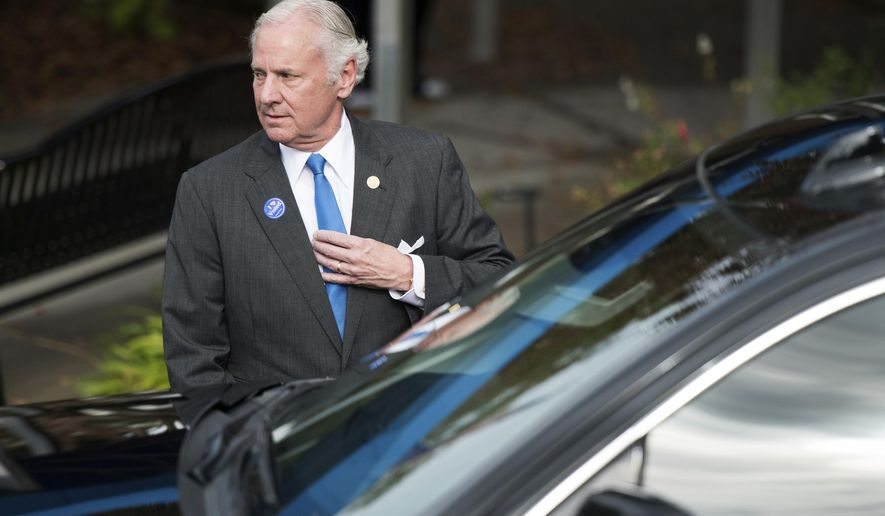 South Carolina Governor Henry McMaster returns to his vehicle after casting votes at a polling station Tuesday, Nov. 6, 2018, in Columbia, S.C. Voters in thirty six states will cast ballots in gubernatorial races on Tuesday. (AP Photo/Sean Rayford)
