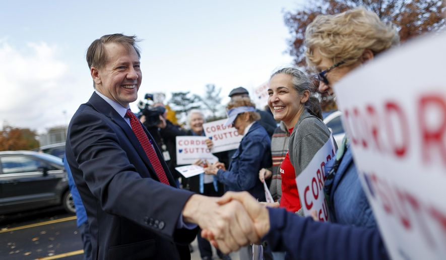 Ohio Democratic gubernatorial candidate Richard Cordray greets supporters at the Whetstone Community Center polling location, Tuesday, Nov. 6, 2018, in Columbus, Ohio. Across the country, voters headed to the polls Tuesday in one of the most high-profile midterm elections in years. (AP Photo/John Minchillo)