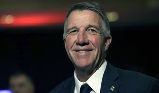 Republican Vermont Gov. Phil Scott smiles during an election night rally party in Burlington, Vt., Tuesday, Nov. 6, 2018. Scott faced Democratic gubernatorial challenger Christine Hallquist, who conceded the race earlier in the evening. (AP Photo/Charles Krupa)
