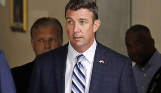 FILE - In this Aug. 23, 2018, file photo, Republican U.S. Rep. Duncan Hunter leaves an arraignment hearing in San Diego after he and his wife, Margaret, pleaded not guilty to charges they illegally used his campaign account for personal expenses. His Democratic opponent is trying to make him pay a political price. Democrat Ammar Campa-Najjar's campaign has been airing TV ads, calling the congressman an embarrassment to the Southern California district. (AP Photo/Gregory Bull, File)