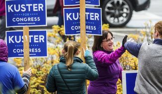 Rep. Annie Kuster greets supporters arrives to vote at the Hopkinton High School in Contoocook, N.H., Tuesday, Nov. 6, 2018. (Geoff Forester /The Concord Monitor via AP) ** FILE **