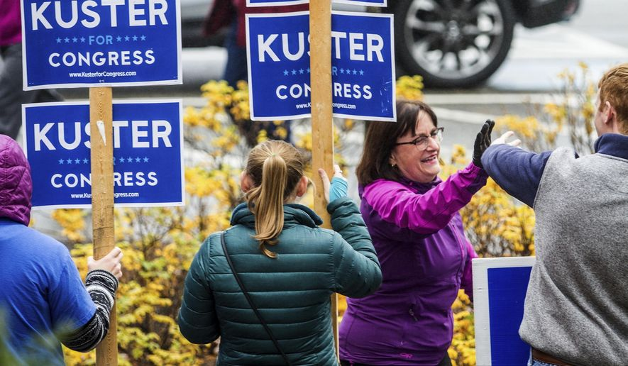 Rep. Annie Kuster greets supporters arrives to vote at the Hopkinton High School in Contoocook, N.H., Tuesday, Nov. 6, 2018. (Geoff Forester /The Concord Monitor via AP)
