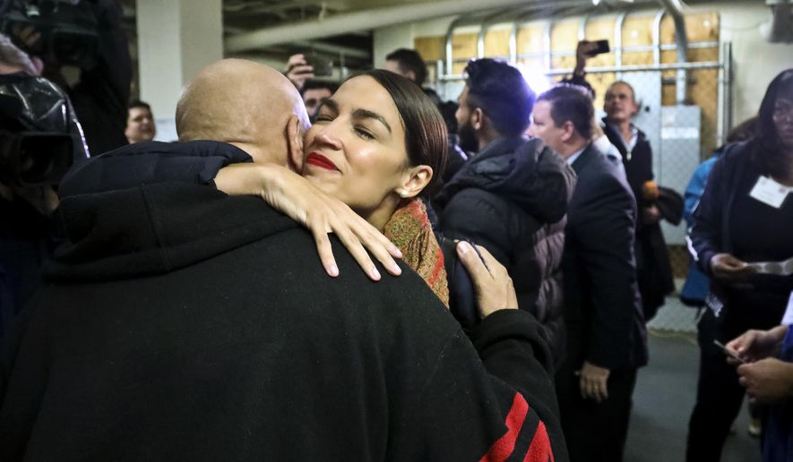 New York Democratic Congressional candidate Alexandria Ocasio-Cortez embraces a supporter at a polling site after voting, Tuesday Nov. 6, 2018, in the Parkchester community in the Bronx, N.Y. (AP Photo/Bebeto Matthews)