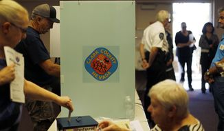 People vote on Election Day at the Enterprise Library Tuesday, Nov. 6, 2018 in Las Vegas. (AP Photo/Joe Buglewicz)