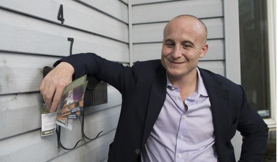 In this Oct. 3, 2018 file photo, Democratic congressional candidate Max Rose campaigns in the Bay Ridge neighborhood of the Brooklyn borough of New York. Rose is running against incumbent Dan Donovan in New York's 11th Congressional District. (AP Photo/Mary Altaffer, File) **FILE**