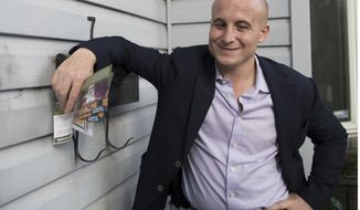FILE - In this Oct. 3, 2018 file photo, Democratic congressional candidate Max Rose campaigns in the Bay Ridge neighborhood of the Brooklyn borough of New York. Rose is running against incumbent Dan Donovan in New York's 11th Congressional District. (AP Photo/Mary Altaffer, File)