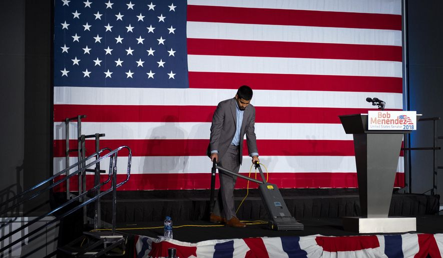 The stage is prepared before the polls close at the election night headquarters of Democratic incumbent Sen. Bob Menendez in Hoboken, N.J., Tuesday, Nov. 6, 2018. (AP Photo/Craig Ruttle)