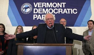 U.S. Sen. Bernie Sanders, I-Vt., thanks supporters after winning re-election during a Democratic election night rally party in Burlington, Vt., Tuesday, Nov. 6, 2018. (AP Photo/Charles Krupa)