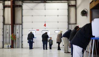 Voters fill out ballots at the Bar Nunn Fire Department Tuesday, Nov. 6, 2018, in Bar Nunn, Wyo. (Josh Galemore/The Casper Star-Tribune via AP)