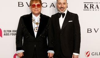 """Elton John, left, and David Furnish attend the Elton John AIDS Foundation's 17th annual """"An Enduring Vision"""" benefit gala at Cipriani 42nd Street on Monday, Nov. 5, 2018, in New York. (Photo by Andy Kropa/Invision/AP)"""