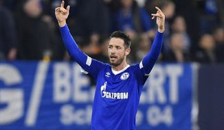 Schalke's Mark Uth celebrates after scoring his side's second goal during the Champions League group D soccer match between FC Schalke 04 and Galatasaray Istanbul in Gelsenkirchen, Germany, Tuesday, Nov. 6, 2018. (AP Photo/Martin Meissner)