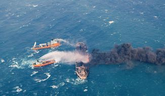 """FILE - In this Jan. 10, 2018 file photo provided by China's Ministry of Transport, firefighting boats work to put on a blaze on the oil tanker Sanchi in the East China Sea off the eastern coast of China. The U.S.'s self-described """"largest-ever"""" sanctions list targeting Iran includes the oil tanker that already sunk and a bank long since closed. Iranian Foreign Minister Mohammad Javad Zarif  in a tweet late Monday, Nov. 5, 2018, called the re-imposition of sanctions a desperate move and said they target ordinary Iranians. (Ministry of Transport via AP, File)"""